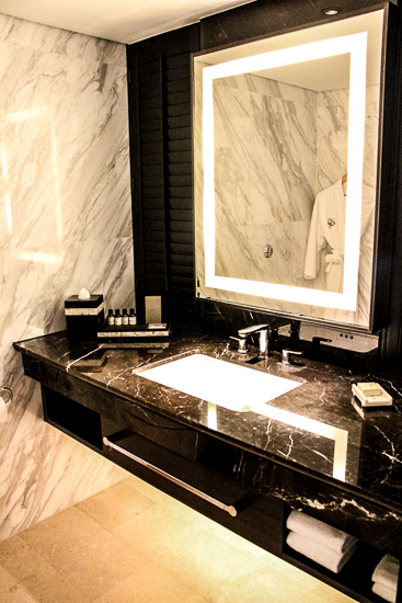 White marble bathroom at best 5 star hotel in Singapore, the Fairmont.