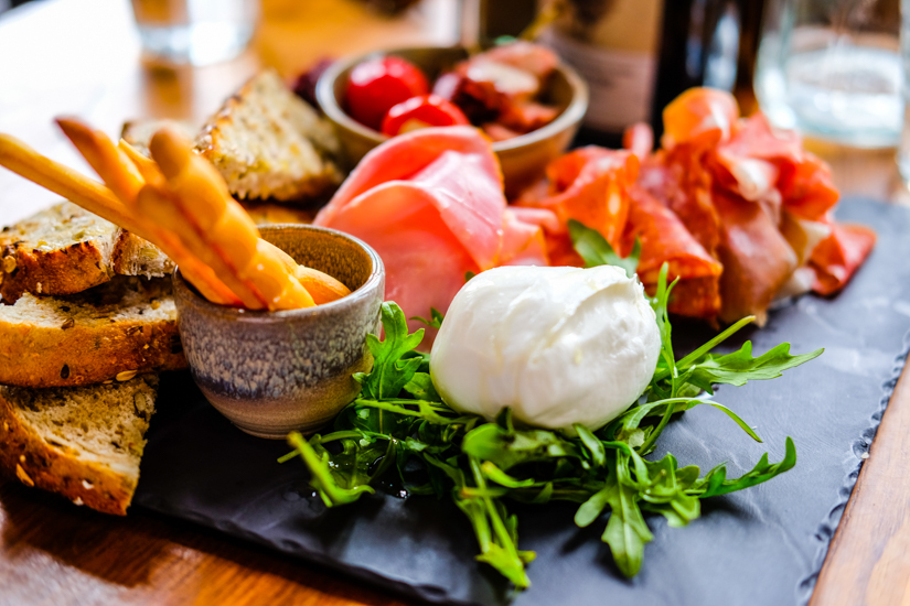 A charcuterie plate at Annie's Provedore overflowing with fresh produce. Image © Sophia Lazarides