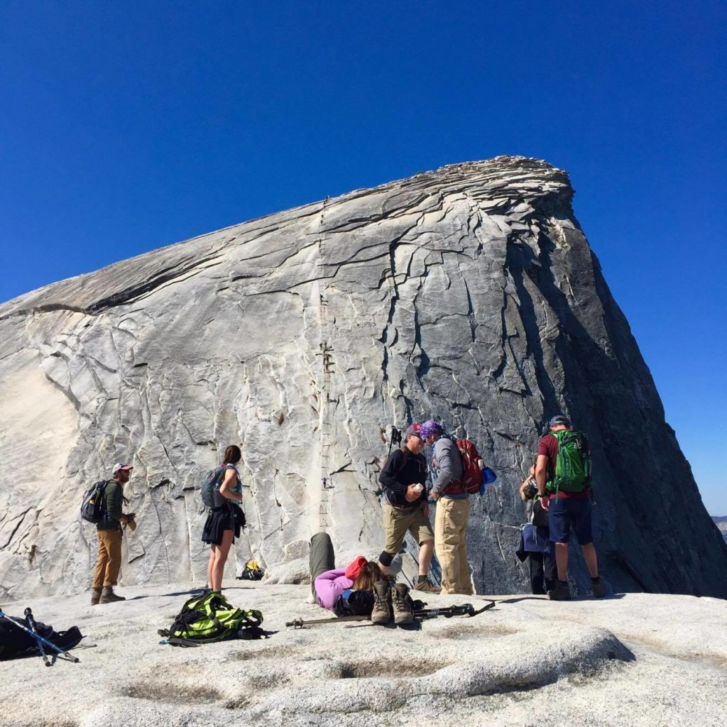 The group gathers by the iconic Half Dome rock face in Yosemite National Park. Image © Gabrielle Boyle