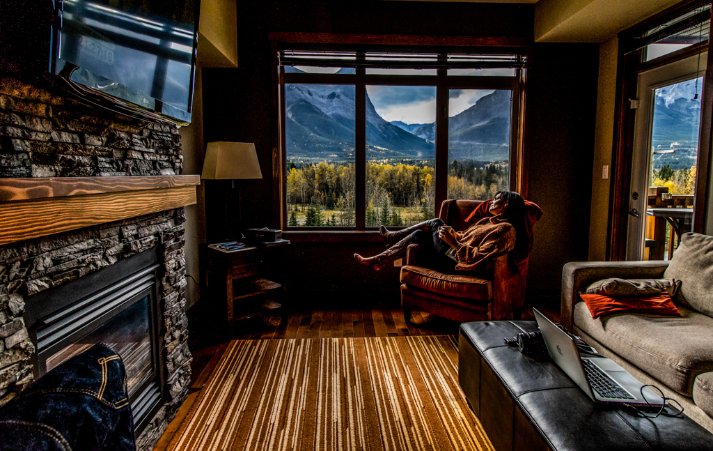 Escaping the screen to take in the magic of the mountains outside our suite's window. Image © Skye Gilkeson
