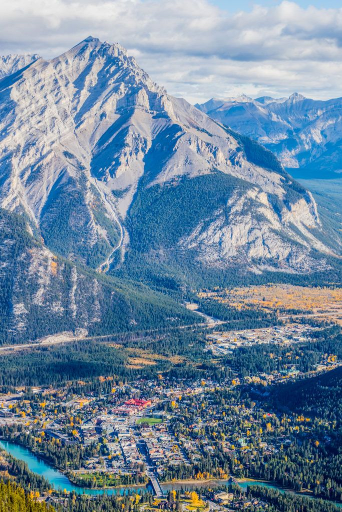 Banff town shrinks in the shadow of the stunning Canadian Rocky Mountains. Image © Skye Gilkeson