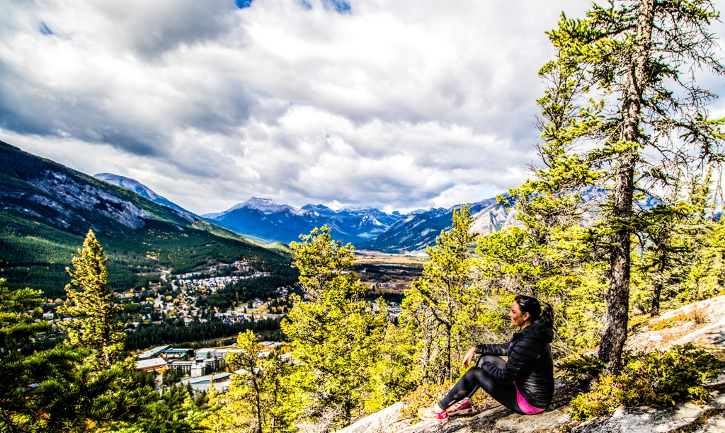 Skye enjoying a moment of quiet and the view over Banff from the Tunnel Mountain Trail. Image © Skye Gilkeson