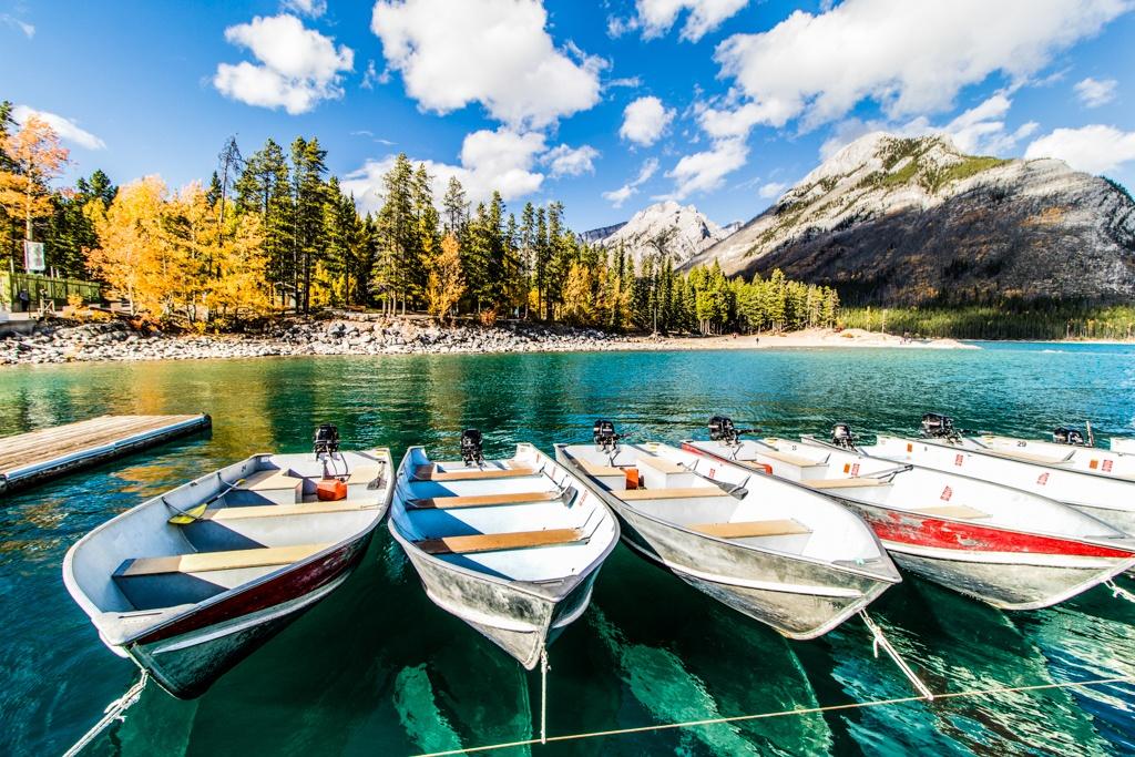 Boats at the ready on the emerald waters of Lake Minnewanka, Banff. Image © Skye Gilkeson