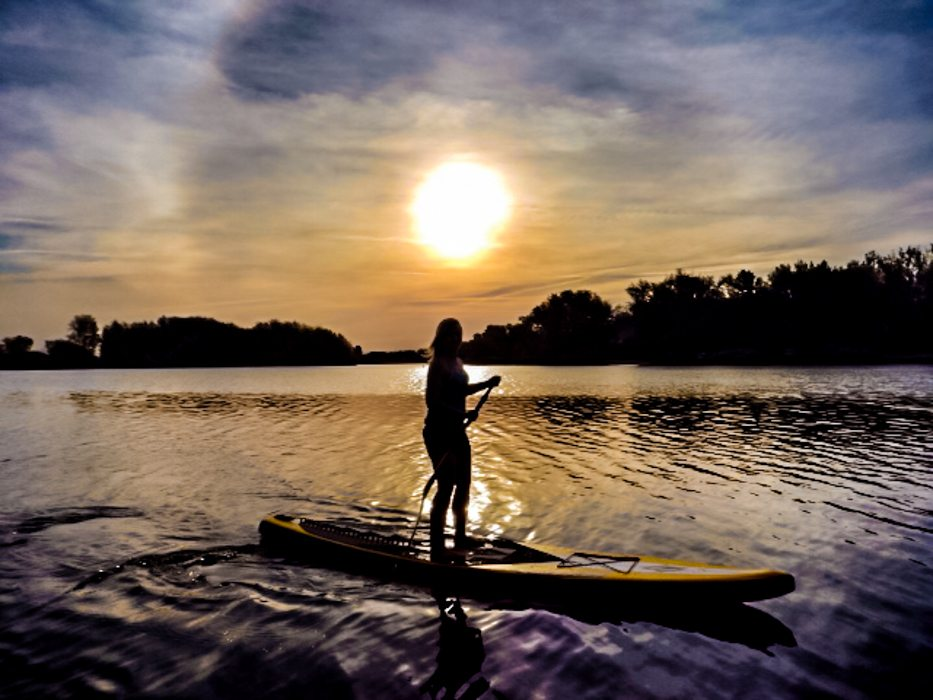 Stand up paddle boarding on one of Canberra's waterways is a great way to explore the city. Image © Amelia Bidgood